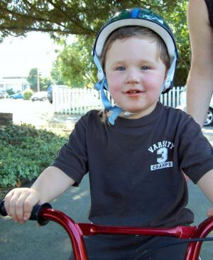 p 4 Kid on bike with helmet